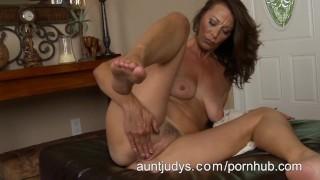 Naughty Milf Mimi Moore finger fucks her pussy